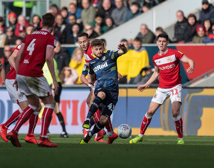 Leeds United's Mateusz Klich (center) battles with  Bristol City's Josh Brownhill (left) <br /> <br /> Photographer David Horton/CameraSport<br /> <br /> The EFL Sky Bet Championship - Bristol City v Leeds United - Saturday 9th March 2019 - Ashton Gate Stadium - Bristol<br /> <br /> World Copyright © 2019 CameraSport. All rights reserved. 43 Linden Ave. Countesthorpe. Leicester. England. LE8 5PG - Tel: +44 (0) 116 277 4147 - admin@camerasport.com - www.camerasport.com