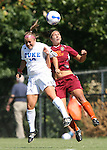 30 September 2007: Duke's CJ Ludemann (10) and Virginia Tech's Laurie Beth Puglisi (r) challenge for a header. The Duke University Blue Devils defeated the Virginia Tech University Hokies 1-0 in sudden death overtime at Koskinen Stadium in Durham, North Carolina in an Atlantic Coast Conference NCAA Division I Women's Soccer game.