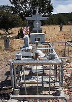 Grave at the Chilili Cemetary in New Mexico. The dozens of tombstones and memorial plaques have been created entirely of large sheets of tin, mounted on marble by Horace McAfee,