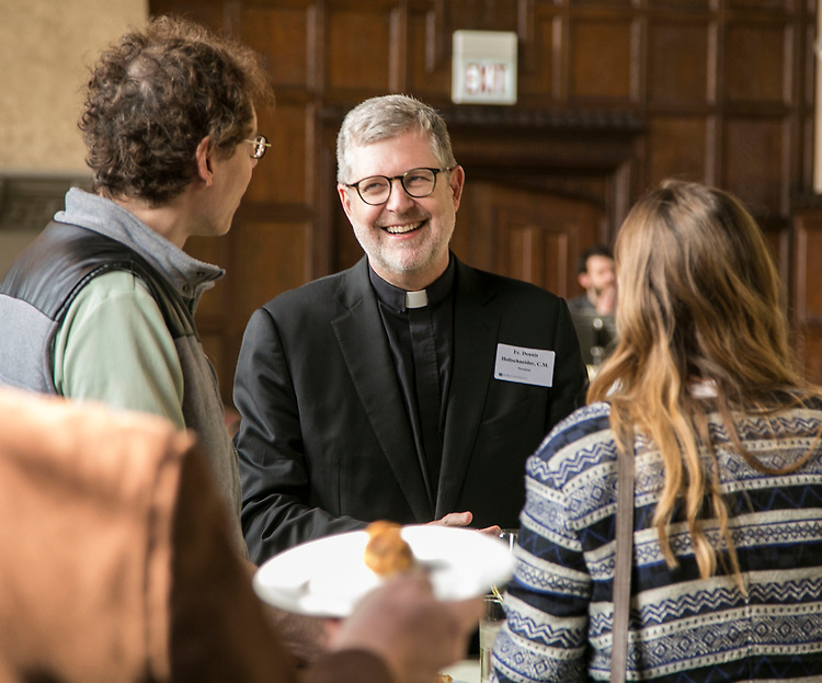 The Rev. Dennis H. Holtschneider, C.M., president of DePaul University talks with Robert Puccinelli, left, and Victoria Hohenzy, right, a member of the Workplace Environment Committee, during a reception Tuesday, May 9, 2017, for adjunct faculty members at Cortelyou Commons. The event was hosted by DePaul's Committee on Contingent Faculty, the Workplace Environment Committee and the Office of Academic Affairs. The event offered adjunct faculty the opportunity to network and for the administration to thank the members and recognize their outstanding contributions to the university and its students. (DePaul University/Jamie Moncrief)
