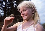 Chameleon and girl in Rwanda