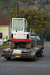 Small backhoe on trailer