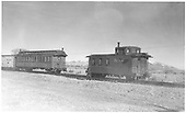 Side-end angle view of long caboose #04343, flying herald, round roof, with reefer, and workcar 0251 - cloach, sleeper, office.<br /> D&amp;RGW  Alamosa, CO  Taken by Richardson, Robert W. - 12/3/1948