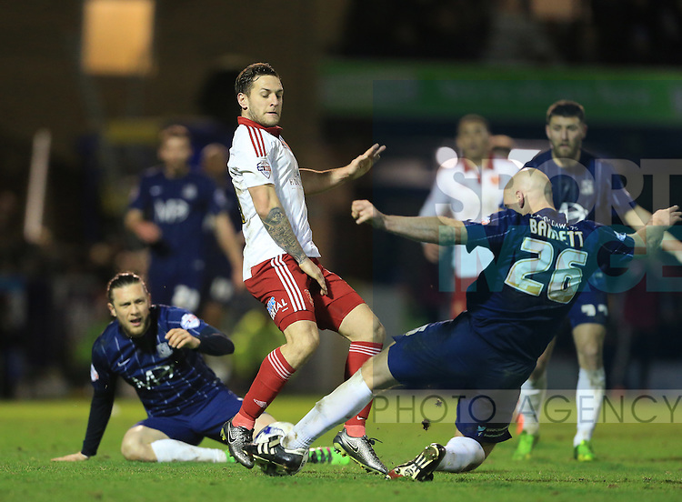 Southend's Adam Barrett tussles with Sheffield United's Billy Sharp during the League One match at Roots Hall Stadium.  Photo credit should read: David Klein/Sportimage
