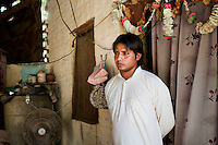 "Sanjay Kumar, 22, a former snake charmer, talks of being a cultural musician at his home in Naraina gaon, Titana village, Samalkha town, Haryana, India on 15th June 2012. ""Only during elections does the government pay attention to us,"" he says. India's snake charmer communities suffer from a loss of livelihood because of stringent wildlife laws and are forced to resort to begging or working as daily wage labourers. A new program to encourage the snake charmer's children to attend school is underway, to keep them from becoming daily-wage child labourers or joining their parents in scavenging and begging in cities. Photo by Suzanne Lee for The National"