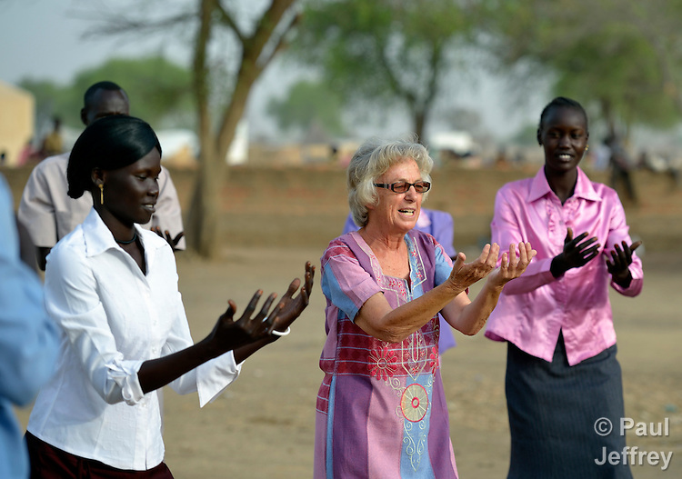 Sister Barbara Paleczny, a School Sister of Notre Dame from Canada, leads displaced teachers in morning stretching and yoga exercises in Agok, a town in the contested Abyei region where tens of thousands of people fled in 2011 after an attack by soldiers and militias from the northern Republic of Sudan on most parts of Abyei. Sister Paleczny is a member of Solidarity with South Sudan, an international network of religious orders and congregations assisting the newly independent country train teachers, health care personnel, and pastoral workers. The teachers in Agok were part of a continuing education program run by Solidarity with South Sudan at the request of the local Catholic parish. .