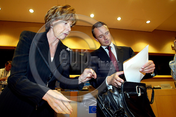 BRUSSELS - BELGIUM  -28 SEPTEMBER 2004--Neelie KROES, Dutch Commissioner designate in charge of Competition, going through her papers with her Chief of Cabinet Ben SMULDERS before the hearing in the European Parliament.--PHOTO: ERIK LUNTANG / EUP-IMAGES..
