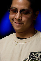 Tim Phan, from WestMinster, CA, one of the final 27 players, competes in the 36th annual World Series of Poker at Binion's Gambling Hall & Hotel on July 14, 2005 in Las Vegas, Nevada. (Photo by Landon Nordeman)