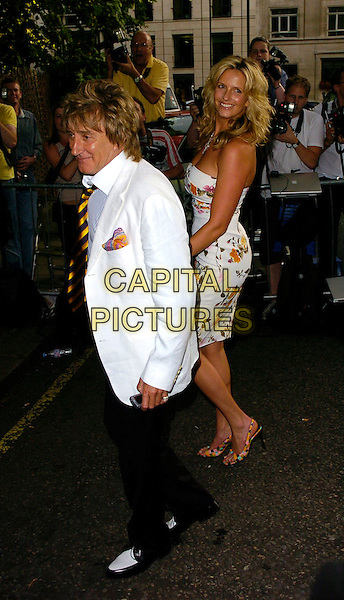 PENNY LANCASTER & ROD STEWART.The BSQUAREB Summer Ball, Berkeley Square, London, UK..Berkeley Square Ball.July 6th, 2006.Ref: CAN.full length white floral print strapless dress black trousers suit jacket couple striped stripes tie slingback shoes.www.capitalpictures.com.sales@capitalpictures.com.©Capital Pictures