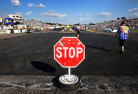 Aug. 16, 2013; Brainerd, MN, USA: A stop sign in the staging lanes behind the starting line during NHRA qualifying for the Lucas Oil Nationals at Brainerd International Raceway. Mandatory Credit: Mark J. Rebilas-