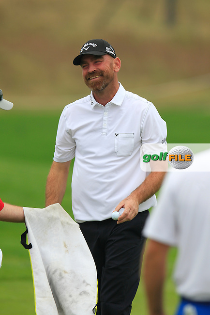 Thomas Bjorn (DEN) on the 1st green during Saturay's Round 3 of the 2014 BMW Masters held at Lake Malaren, Shanghai, China. 1st November 2014.<br /> Picture: Eoin Clarke www.golffile.ie