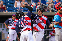 Quad Cities River Bandits catcher Michael Papierski (9) and outfielder Corey Julks (15) celebrate following a home run by Papierski during a Midwest League game against the Peoria Chiefs on May 27, 2018 at Modern Woodmen Park in Davenport, Iowa. Quad Cities defeated Peoria 8-3. (Brad Krause/Four Seam Images)