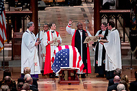 Members of the clergy stand over the flag-draped casket of former President George H.W. Bush during his State Funeral at the National Cathedral, Wednesday, Dec. 5, 2018, in Washington. <br /> CAP/MPI/RS<br /> &copy;RS/MPI/Capital Pictures