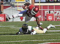 NWA Media/Michael Woods --10/25/2014-- w @NWAMICHAELW...University of Arkansas fullback Patrick Arinze is tripped up just short of the goal line by UAB defender Darius Williams in the 1st quarter of Saturday's game at Razorback Stadium in Fayetteville.
