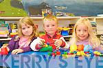Junior Infant pupils Niamh Nic Domhnaill, Cathal Feirtéar and Sadhbh Ní Shlattara, Scoil Dhún Chaoin, on their first day at school.