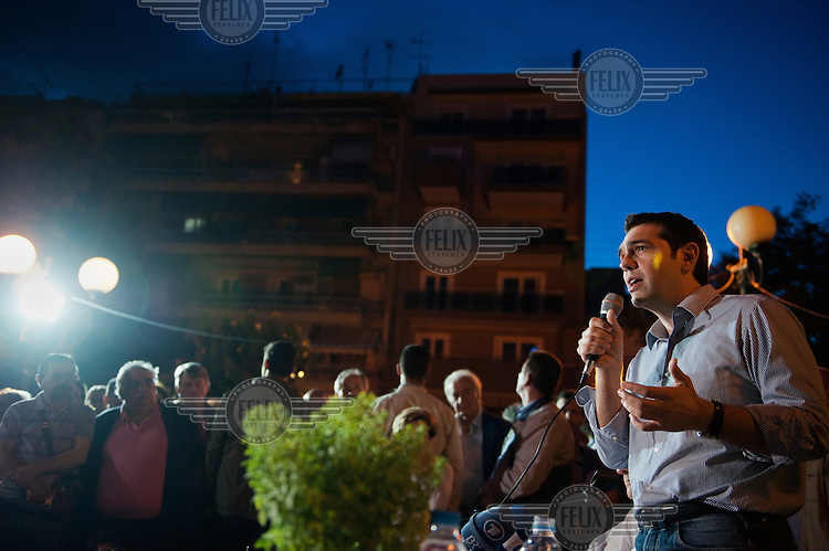 Opposition party Synasmispos president Alexis Tsipras answers the crowd's questions at the Assembly of SYRIZA (the Coalition of the Radical Left parliamentary group, of which he is the head) in Aghia Ekaterini Square, in the Kato Petralona neighbourhood  of Athens.