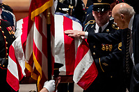 Former Sen. Alan Simpson, R-Wyo, touches the flag-draped casket of former President George H.W. Bush as it is carried out by a military honor guard during a State Funeral at the National Cathedral, Wednesday, Dec. 5, 2018, in Washington. <br /> CAP/MPI/RS<br /> &copy;RS/MPI/Capital Pictures