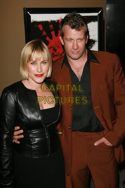 """PATRICIA ARQUETTE & THOMAS JANE.""""The Tripper"""" Los Angeles Premiere - Arrivals held at Mann's Chinese Theatre, Hollywood, California, LA, USA,.13 October 2006..half length red lipstick fringe black jacket.Ref: ADM/ZL.www.capitalpictures.com.sales@capitalpictures.com.©Zach Lipp/AdMedia/Capital Pictures."""