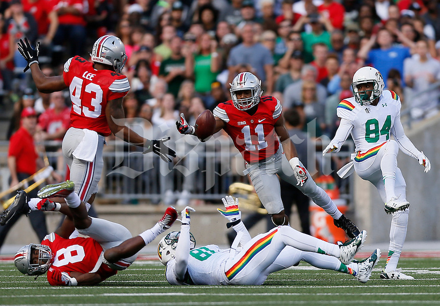 Ohio State Buckeyes safety Vonn Bell (11) intercepts a pass intended for Hawaii Warriors wide receiver Vasquez Haynes (81) during the second quarter of the NCAA football game at Ohio Stadium in Columbus on Sept. 12, 2015. (Adam Cairns / The Columbus Dispatch)