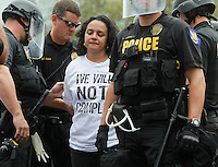 1070hearing  165593 7/22/10-  Protestor Marisa Franco is arrested  by  Phoenix Police officers in the intersection of Fourth Avenue and Washington Street after protestors filled the intersection and refused leave while protesting against SB 1070. (Pat Shannahan/ The Arizona Republic)