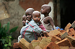 Children play on top of a pile of bricks outside of Kasese in rural Southwestern Uganda.