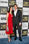 UK actor Colin Firth arrives with his wife Livia at the 25th Independent Spirit Awards held at the Nokia Theater in Los Angeles on March 5, 2010. The Independent Spirit Awards is a celebration honoring films made by filmmakers who embody independence and originality..Photo by Nina Prommer/Milestone Photo