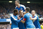 Dean Shiels celebrates his goal as Andy Halliday jumps over