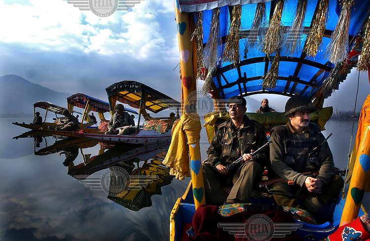 Indian Border Security Force soldiers patrol the picturesque Dal Lake in boats.