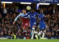 30th November 2019; Stamford Bridge, London, England; English Premier League Football, Chelsea versus West Ham United; Fikayo Tomori of Chelsea is marked by Sebastien Haller of West Ham United  - Strictly Editorial Use Only. No use with unauthorized audio, video, data, fixture lists, club/league logos or 'live' services. Online in-match use limited to 120 images, no video emulation. No use in betting, games or single club/league/player publications