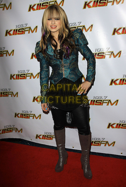 ORIANTHI (Orianthi Panagaris).at KIIS FMís Jingle Ball 2009, Nokia LA Live Theatre, Los Angeles, California, USA, 5th December 2009..full length green jacket shoulder pads teal blue black skirt brown grey gray knee high boots patterned brocade pattern print .CAP/ADM/KB.©Kevan Brooks/AdMedia/Capital Pictures.