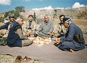 Iraq 1997  <br /> A lunch near Penjwin, in Kani Hermen, during the civil war between PUK and KDP: in the middle,Mullazem Omar Abdallah, next, Mahmoud Sangawy and Kendo Hassan  <br /> Irak 1997  <br /> Pendant la guerre civile entre l'UPK et le PDK, dejeuner a Kani Hemer, pres de Penjwin avec Mullazem Omar Abdallah, Mahmoud Sangawy , Kendo hassan