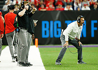 Ohio State Buckeyes head coach Urban Meyer yells a play from the sidelines during the second quarter of the Big Ten Conference Football Championship between the Ohio State Buckeyes and the Northwestern Wildcats on Saturday, December 1, 2018 at Lucas Oil Stadium in Indianapolis, Indiana. [Joshua A. Bickel/Dispatch]