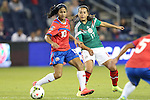 16 October 2014: Veronica Perez (MEX) (17) and Shirley Cruz (CRC) (10). The Mexico Women's National Team played the Costa Rica Women's National Team at Sporting Park in Kansas City, Kansas in a 2014 CONCACAF Women's Championship Group B game, which serves as a qualifying tournament for the 2015 FIFA Women's World Cup in Canada. Costa Rica won the game 1-0.