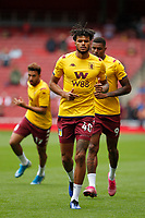 Tyrone Mings of Aston Villa warms up during the Premier League match between Arsenal and Aston Villa at the Emirates Stadium, London, England on 22 September 2019. Photo by Carlton Myrie / PRiME Media Images.