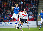 St Johnstone v Dundee.....02.01.13      SPL.Liam Craig outjumps Gary Irvine.Picture by Graeme Hart..Copyright Perthshire Picture Agency.Tel: 01738 623350  Mobile: 07990 594431
