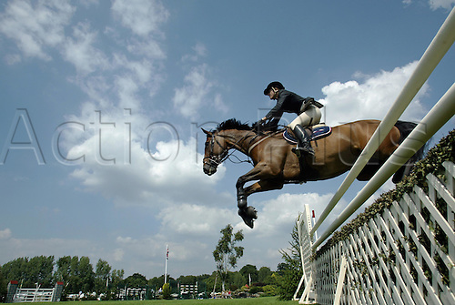 18 August 2005:  British rider Katie Jackaman jumping a fence on UDALLY VAN OVERIS in The Hickstead Derby Salver on the first day of The British Jumping Derby Meeting, Hickstead, England Photo: Glyn Kirk/actionplus...050818 horse rider female woman women jump jumping fence riding