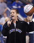University of Kentucky men's basketball head coach John Calipari holds up an autographed basketball while asking for donations for fans for UK's new scholarship program. People who donate to the scholarship are entered to win the basketball...Photo by Ed Matthews | Staff