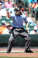 Home plate umpire Brad Myers makes a call during a game between the Rochester Red Wings and Buffalo Bisons at Frontier Field on August 2, 2011 in Rochester, New York.  Rochester defeated Buffalo 7-3.  (Mike Janes/Four Seam Images)