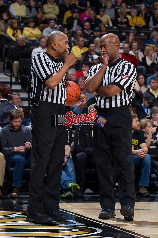 Official Tony Greene (left) chats with fellow official Sean Hull during a first half time out in the ACC men's basketball game between the Duke Blue Devils and the Wake Forest Demon Deacons at the LJVM Coliseum on January 7, 2015 in Winston-Salem, North Carolina.  The Blue Devils defeated the Demon Deacons 73-65.  (Brian Westerholt/Sports On Film)