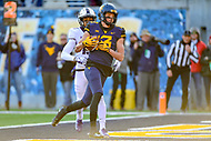 Morgantown, WV - NOV 10, 2018: West Virginia Mountaineers quarterback Will Grier (7) throws a strike downfield for a touchdown to West Virginia Mountaineers wide receiver David Sills V (13) during game between West Virginia and TCU at Mountaineer Field at Milan Puskar Stadium Morgantown, West Virginia. (Photo by Phil Peters/Media Images International)