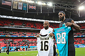 1st October 2017, Wembley Stadium, London, England; NFL International Series, Game Two; Miami Dolphins versus New Orleans Saints; Leonte Carroo of the Miami Dolphins and Brandon Coleman of the New Orleans Saints exchange shirts