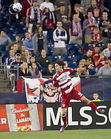 FC Dallas defender Zach Loyd (91) heads the ball. In a Major League Soccer (MLS) match, the New England Revolution defeated FC Dallas, 2-0, at Gillette Stadium on September 10, 2011.