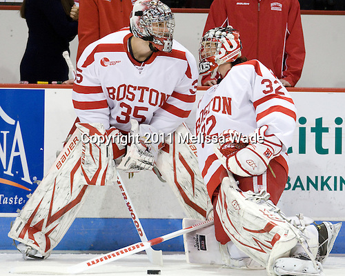 Grant Rollheiser (BU - 35), Adam Kraus (BU - 32) - The visiting Northeastern University Huskies defeated the Boston University Terriers 4-3 on BU's senior night on Saturday, March 5, 2011, at Agganis Arena in Boston, Massachusetts.
