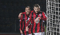 Jamie Devitt (left) of Morecambe celebrates scoring his penalty during the Sky Bet League 2 match between Wycombe Wanderers and Morecambe at Adams Park, High Wycombe, England on 2 January 2016. Photo by Andy Rowland / PRiME Media Images