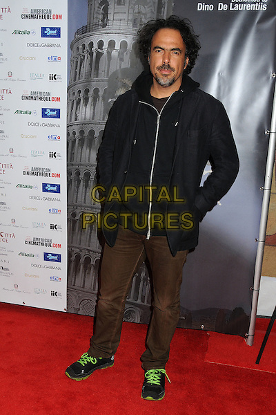 "Alejandro Gonzalez Inarritu .Cinema Italian Style 2011 Opening Night Gala Screening of ""Terraferma"" held at Grauman's Egyptian Theatre, Hollywood, California, USA,.11th November 2011.full length black hood  jacket brown trousers .CAP/ADM/BP.©Byron Purvis/AdMedia/Capital Pictures."