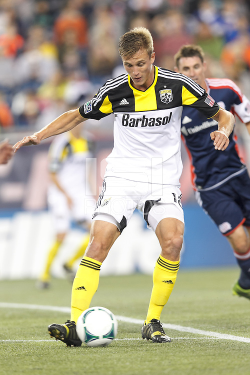 Columbus Crew substitute forward Aaron Schoenfeld (18) dribbles. In a Major League Soccer (MLS) match, the New England Revolution (blue) defeated Columbus Crew (white), 3-2, at Gillette Stadium on October 19, 2013.