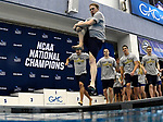 GREENSBORO, NC - MARCH 17: The NCAA Champion Queens University of Charlotte Royals Men's Swimming and Diving team jump into the diving well in celebration following the conclusion of the Division II Men's and Women's Swimming & Diving Championship held at the Greensboro Aquatic Center on March 17, 2018 in Greensboro, North Carolina. (Photo by Mike Comer/NCAA Photos/NCAA Photos via Getty Images)
