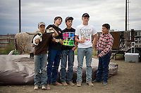 The winning children's team poses for pictures at the Mechanical Bull-A-Rama at the Whoa Arena in Valier, Montana, USA.  The event, organized by Janelle Nelson, was a benefit for local youth rodeo participants and the local food bank.
