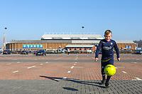 A young Leeds United fan kicks a ball around outside Elland Road<br /> <br /> Photographer Alex Dodd/CameraSport<br /> <br /> The EFL Sky Bet Championship - Leeds United v Bolton Wanderers - Saturday 23rd February 2019 - Elland Road - Leeds<br /> <br /> World Copyright © 2019 CameraSport. All rights reserved. 43 Linden Ave. Countesthorpe. Leicester. England. LE8 5PG - Tel: +44 (0) 116 277 4147 - admin@camerasport.com - www.camerasport.com