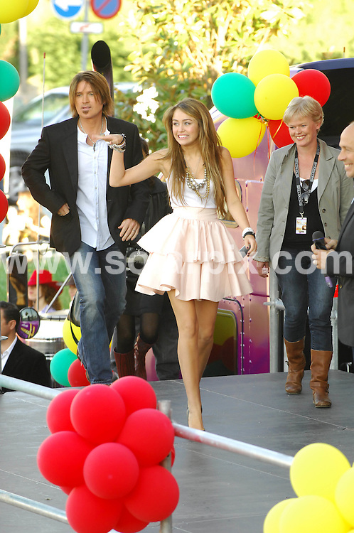 **ALL ROUND PICTURES FROM SOLARPIX.COM**.**SYNDICATION RIGHTS FOR UK, ASIA, AUSTRALIA, CANADA, DUBAI, GREECE, NEW ZEALAND, RUSSIA, SOUTH AFRICA, SOUTH AMERICA, AND USA**.Miley Cyrus in Madrid, Spain, at a photocall for the film Hannah Montana. Held at Kinepolis Cinema, Madrid, Spain. 21 April 2009..This pic: Billy Ray Cyrus and Miley Cyrus..JOB REF: 8857 SPA     DATE: 21_04_2009.**MUST CREDIT SOLARPIX.COM OR DOUBLE FEE WILL BE CHARGED**.**ONLINE USAGE FEE GBP 50.00 PER PICTURE - NOTIFICATION OF USAGE TO PHOTO @ SOLARPIX.COM**.**CALL SOLARPIX : +34 952 811 768 or LOW RATE FROM UK 0844 617 7637**
